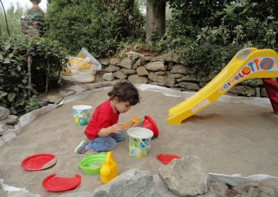 having fun in the sandpit
