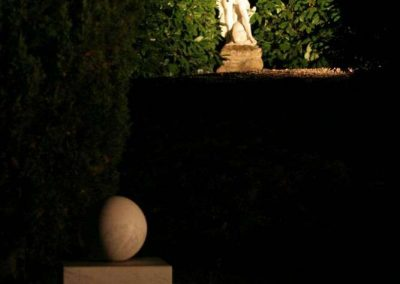 statues in garden at night